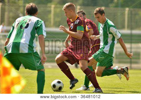 KAPOSVAR, HUNGARY - AUGUST 26: Krisztian Kircher (green 6) in action at a Hungarian Championship II. soccer game Kaposvar II. (green) vs. Paks II. (claret) August 26, 2012 in Kaposvar, Hungary.