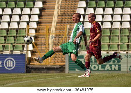 KAPOSVAR, HUNGARY - AUGUST 26: Patrik Bojte (green 17) in action at a Hungarian Championship II. soccer game Kaposvar II. (green) vs. Paks II. (claret) August 26, 2012 in Kaposvar, Hungary.