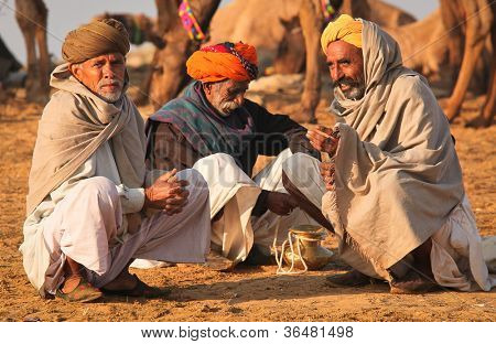 PUSHKAR, INDIA - NOVEMBER 19: Unidentified men attends the Pushkar fair on November 19, 2010 in Pushkar, Rajasthan, India. Pilgrims and camel traders flock to the holy town for the annual fair.