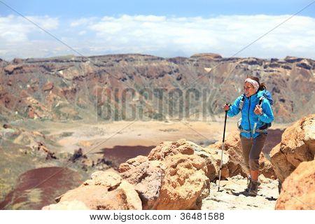 Woman hiking on volcano Teide, Tenerife. Hiker near summit of Teide during hike on Tenerife, Canary Islands, Spain.
