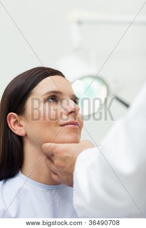Woman patient being auscultated by a doctor in an examination