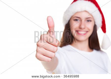 happy smiley girl in santa hat showing thumbs up. focus on fingers