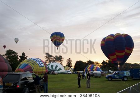 NORTHAMPTON, ENGLAND - AUGUST 18: Hot Air Balloons launching at the Northampton Balloon Festival, on August 18, 2012 in Northampton, England.