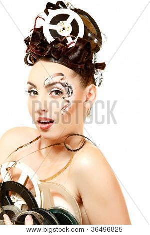 vintage woman with beautiful art film movie make-up and hairstyle holding spools isolated on white background