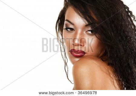 Beauty portrait of young mulatto fresh woman with beautiful makeup in profile over white background