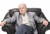 picture of venereal disease  - Portrait of a senior man sitting in an armchair - JPG