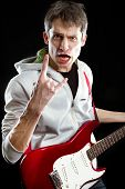 foto of stratocaster  - Man with red electric guitar - JPG
