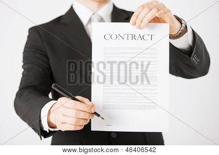 picture of man hands holding contract with random text
