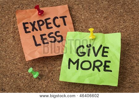 expect less, give more - motivation or self improvement concept - handwriting on colorful sticky notes
