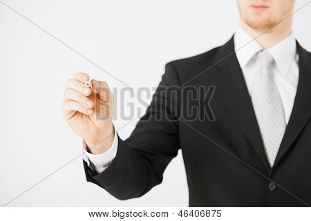 close up of man writing something in the air