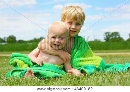 Brothers Hugging In Beach Towel