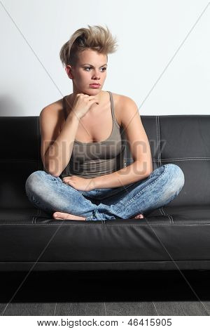 Fashion Teenager Girl Pensive Sitting On A Couch