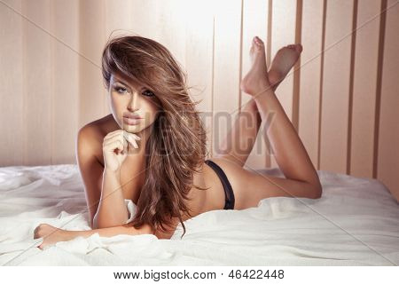 Sensual Lady Posing On White Bed, Looking At Camera.