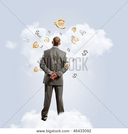 Image of thoughtful businessman standing with back
