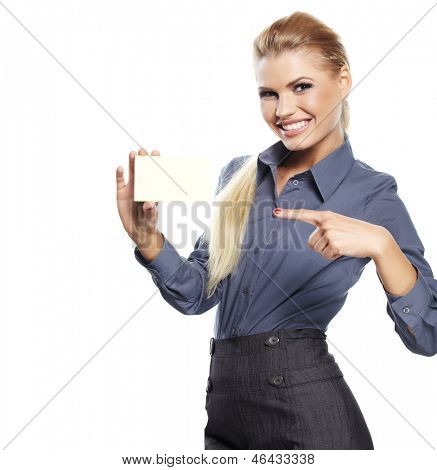 Happy blond woman showing blank credit card.