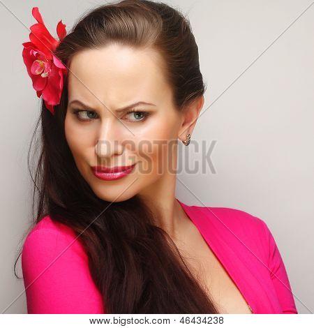 Woman making a funny face.Studio shot.