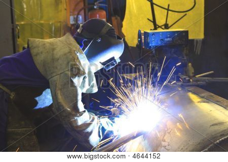 Arc Welder Finishing A Tank