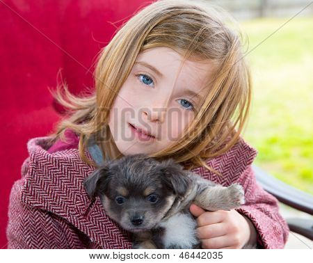 Blond girl hug a gray puppy chihuahua dog with winter coat