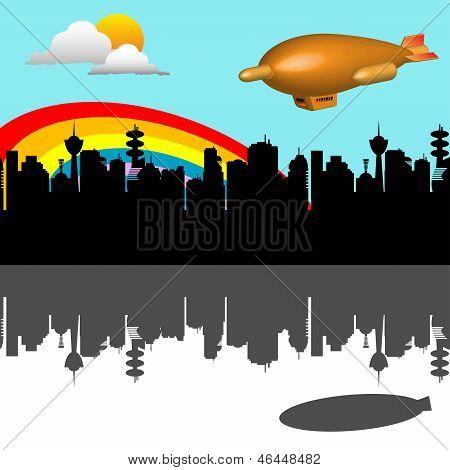 Blimp flying over the city