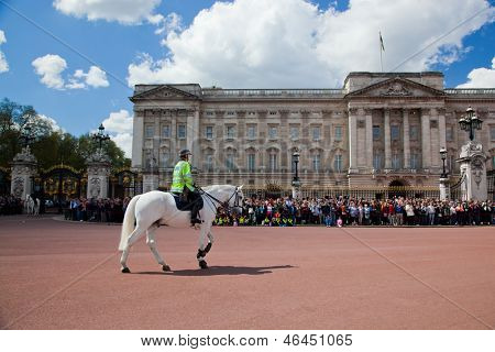 LONDON - MAY 17: British Royal guards riding on horse and perform the Changing of the Guard in Buckingham Palace on May 17, 2013 in London, UK
