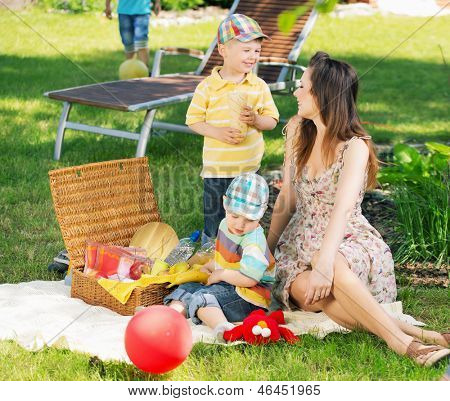 Happy family picnicking