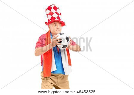 Mature male fan, with hat and flag of Holland, holding a soccer ball isolated on white background