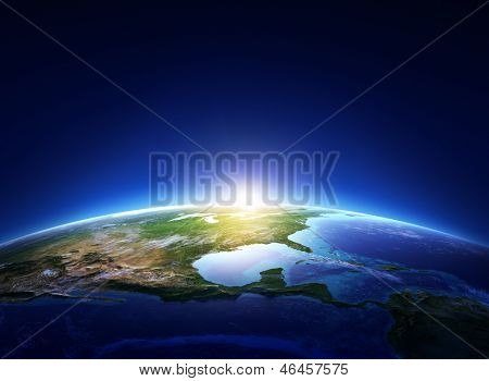 Earth sunrise North America with light clouds  (Elements of this image furnished by NASA)