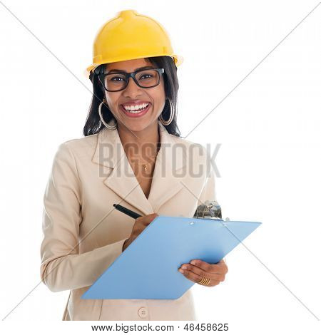 Smiling Indian female construction engineer with safety helmet smiling happy writing report. Portrait of beautiful Asian female model standing isolated on white background.