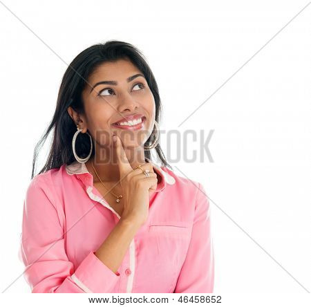 Indian woman thinking. India businesswoman having a thought, finger on chin looking up smiling happy. Portrait of beautiful Asian female model standing isolated on white background.