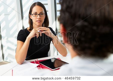 Businesswoman Interviewing Male Candidate For Job