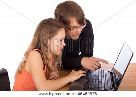 Father And Daughter Working On A Laptop