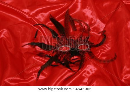 Red Mask On Silk