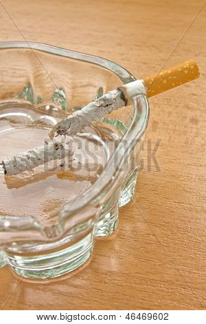 Cigarette In A Glass Ashtray