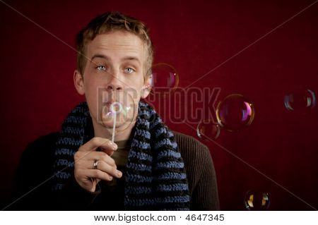 Young Man Blowing A Bubbles