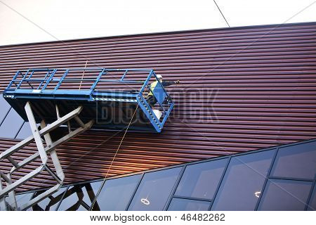 Builder On A Scissor Lift Platform On A Construction Site