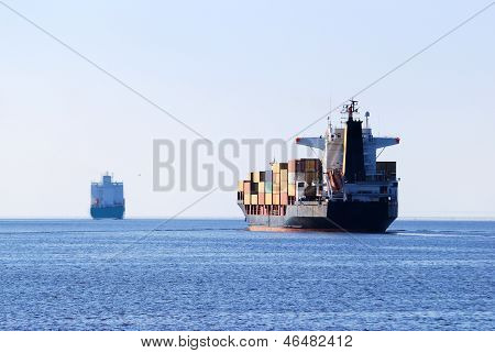Cargo Ship Sailing In Still Water