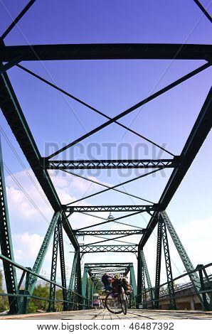 Bicycle On Historical Iron Bridge, Cloudy and Blue Sky