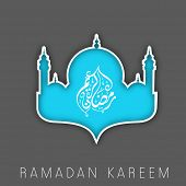 Arabic Islamic calligraphy of text Ramadan Kareem in Mosque design on grey background for Ramadan Ka