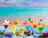 stock photo of mayan  - Colorful many tropical Cocktails in tropical blue wood at turquoise beach with coconut mojito margarita - JPG