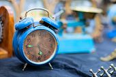 stock photo of flea  - Vintage blue alarm clock at flea market - JPG
