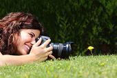 image of megapixel  - Profile of a beautiful woman taking a macro photography of a flower on the grass in a park - JPG