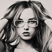portrait of beautiful blond woman in glasses
