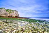 Etretat Aval Cliff Landmark And Its Beach In Low Tide. Normandy, France. poster