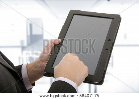 Businessman Using A Tablet Pc On The Office