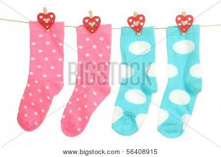 Socks hanging on clothesline isolated on white