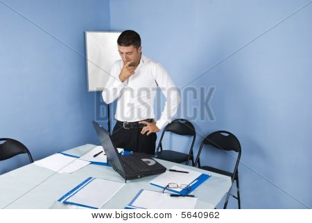 Pensive Business Man In Meeting Room