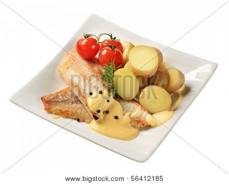 Pan fried fish fillets with potatoes and Hollandaise sauce