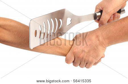 Hand cut off spatula.