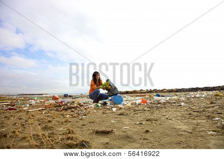 Young Activist Cleaning Dirty Beach