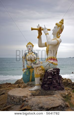 Buddhist statue near the ocean in Thailand